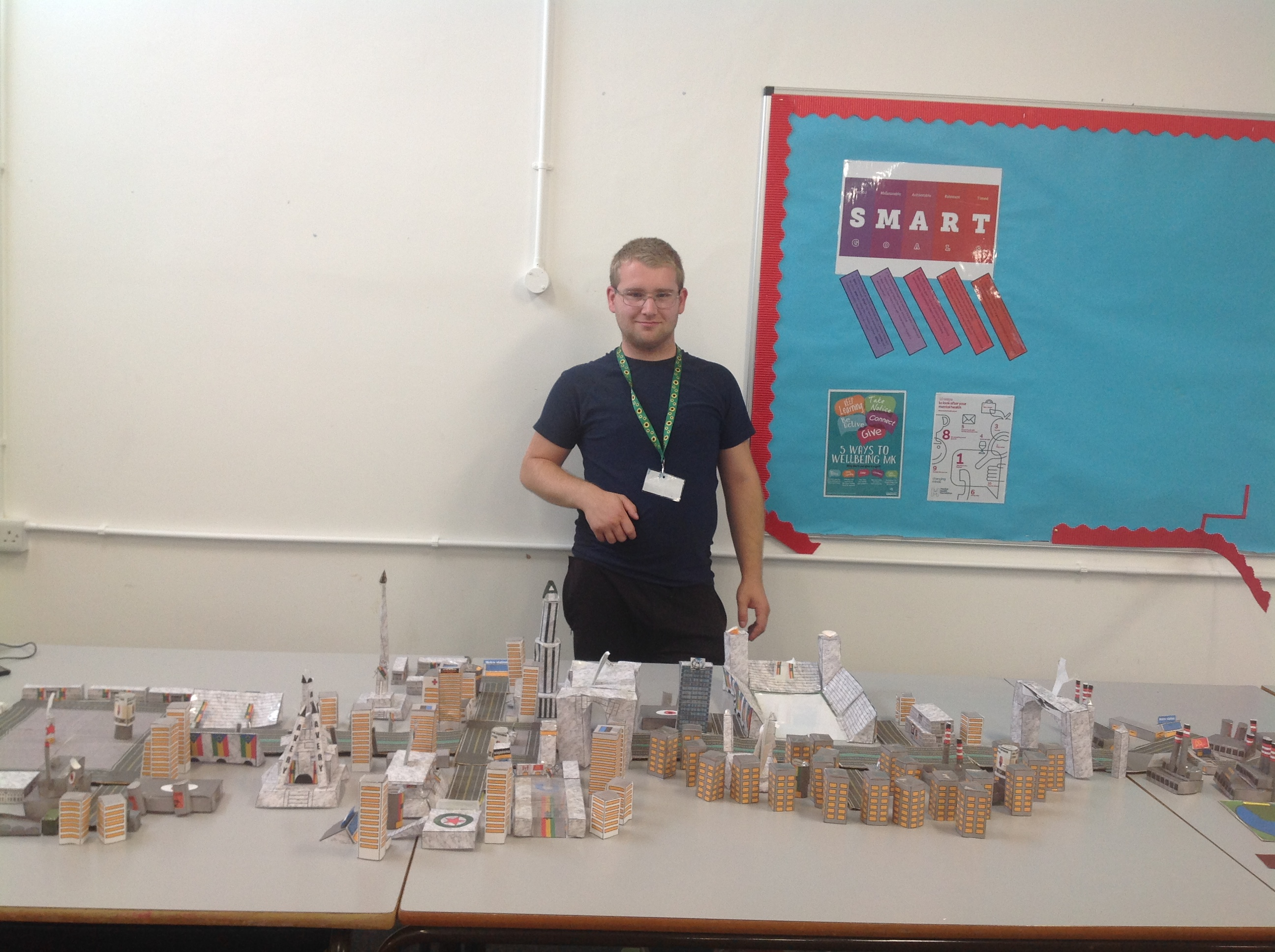Declan standing with his model city